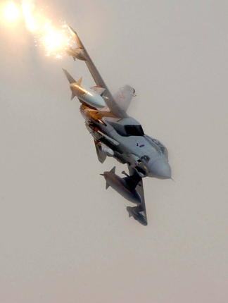 A Royal Air Force GR4 Tornado releases flares during a combat mission over Iraq, 22nd Apri  2004.  DoD photo by Staff Sgt. Aaron Allmon II, U.S. Air Force.