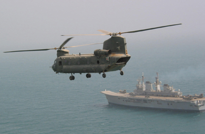 RAF Chinook helicopters of 18 Squadron flying past HMS Ark Royal off the Kuwaiti coast, 12th March 2003. Photograph copyright Tim Ripley