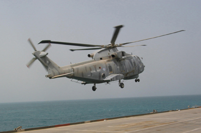 Westland Merlin MPH Mk1 helicopter lands on HMS ARk Royal off the Kuwaiti coast, 12th March 2003. Photograph copyright Tim Ripley